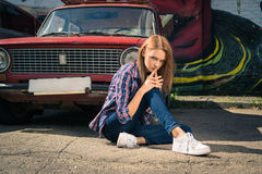 Young attractive model is sitting near the retro car Royalty Free Stock Photography