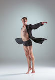 The young attractive modern ballet dancer on gray Royalty Free Stock Images