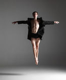 The young attractive modern ballet dancer jumping Stock Images