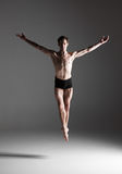 The young attractive modern ballet dancer jumping Royalty Free Stock Photo