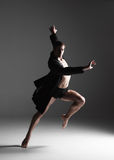 The young attractive modern ballet dancer on white Stock Photography