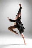 The young attractive modern ballet dancer on white Stock Images