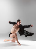 The young attractive modern ballet dancer on white Royalty Free Stock Photo