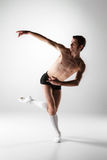 The young attractive modern ballet dancer on white Royalty Free Stock Photography