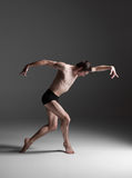The young attractive modern ballet dancer on white Stock Photo