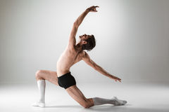 The young attractive modern ballet dancer on white Stock Image