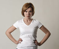 Young attractive and moody woman posing alone angry and upset in bad mood and rage face. Expression isolated on grey background looking defiant and off stock photos