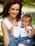 Young attractive mother with her baby Royalty Free Stock Images