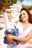 Young attractive mother with her baby Stock Images