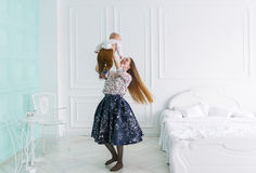 Young attractive mother plays with her baby at home Royalty Free Stock Photography
