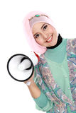 Young attractive muslim woman holding megaphone Stock Photo