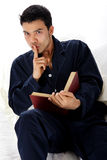 Young attractive nepalese man in pajamas, quiet Royalty Free Stock Photo