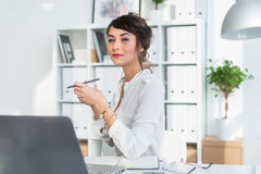 Young attractive office worker drinking cup of tea, having coffee break in the morning, getting ready for work day. Royalty Free Stock Photography