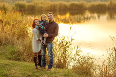 Young Attractive Parents and Child Portrait Stock Photo