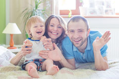 Young Attractive Parents and Child Portrait Stock Images