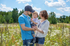 Young Attractive Parents and Child Portrait Stock Photos