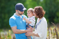 Young Attractive Parents and Child Portrait Stock Image