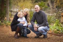 Young Attractive Parents and Child Portrait in Park Royalty Free Stock Photo