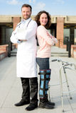 Young attractive patient and a doctor after a reeducation sessio Royalty Free Stock Photos