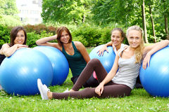 Young and attractive people doing fitness Royalty Free Stock Image