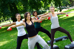 Young and attractive people doing fitness Stock Photography