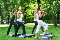 Young and attractive people doing fitness stock images