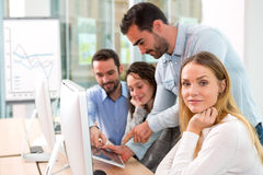 Young attractive people taking a training course with formator Stock Photo