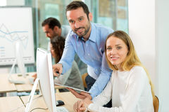 Young attractive people taking a training course with formator Stock Image