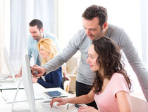 Young attractive people taking a training course Stock Images