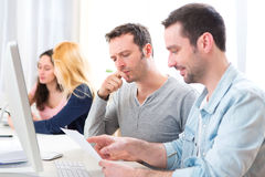 Young attractive people working together at the office Royalty Free Stock Images