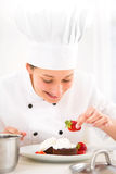 Young attractive professional chef cooking in his kitchen Stock Photos