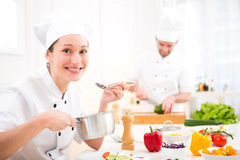 Young attractive professional chef cooking in his kitchen Royalty Free Stock Photos