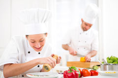 Young attractive professional chef cooking in his kitchen Royalty Free Stock Photography