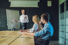 Young, attractive professionals having business training stock image