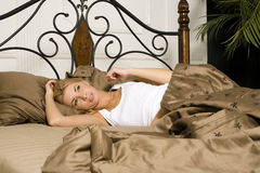 Young attractive real blond woman in bed sexual pose, lifestyle people concept Royalty Free Stock Image