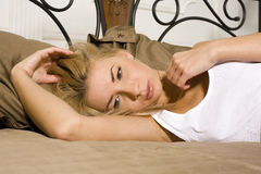 Young attractive real blond woman in bed sexual pose, lifestyle people concept Stock Photography