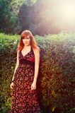 Attractive red-haired girl in a summer park Stock Photo