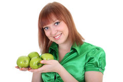 Young attractive red-haired woman with green apple Stock Photography