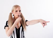 Football referee whistling and pointing to side Royalty Free Stock Photo