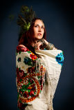 Young attractive retro model in old-fashioned wild clothing danc Stock Photography