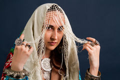 Young attractive retro model in old-fashioned wild clothing dancing royalty free stock photo