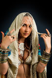 Young attractive retro model in old-fashioned wild clothing dancing royalty free stock photos