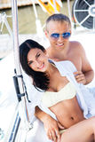 Young, attractive and rich couple on a boat Stock Photography