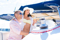 Young, attractive and rich couple have a party on a luxury sailing boat Stock Images