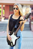 Young attractive rock girl with electric guitar Royalty Free Stock Image