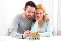Young attractive 30s couple making home project Royalty Free Stock Photography