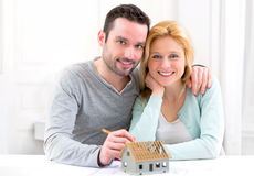 Young attractive 30s couple making home project Royalty Free Stock Images