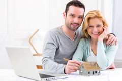 Young attractive 30s couple making home project Stock Image