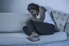Young attractive and sad black African American woman sitting depressed at home sofa couch feeling anxious and frustrated sufferin. Young attractive and sad stock photos