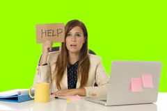 Young attractive sad and desperate businesswoman suffering stress at office laptop computer desk green croma key background royalty free stock photos